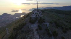 Aerial view of the top of the mountain above Dubrovnik at sunset Stock Footage