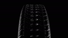 Close up on a car tire in motion Stock Footage