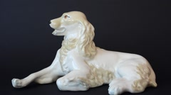 Shooting of a figurine of a spaniel. - stock footage