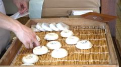 Grill Daifuku umegae-mochi at Dazaifu Temmangu Shrine, Fukuoka Japan Stock Footage