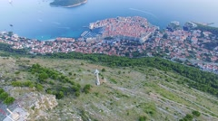 Aerial view of the cableway above Dubrovnik at sunset Stock Footage