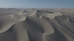 Aerial view of massive sand dunes, desert landscape Dunhuang China Stock Footage