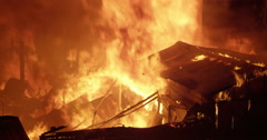 Intense fire inferno consumes a poor settlement Stock Footage