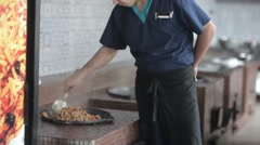 Cook pilaf mixes in the boiler in the kitchen. Stock Footage