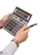Male businessman using a calculator Stock Photos