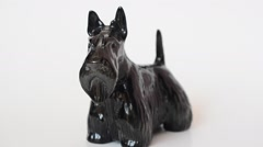 Shooting of a figurine of a terrier. - stock footage