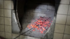 Male hand corrected poker coals in the furnace. Stock Footage