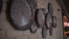 The wall is decorated with a pattern of plates. Stock Footage