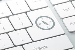 Travel concept: Compass on computer keyboard background Stock Illustration