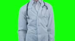 Smiling Doctor giving a hand for help, standing on chroma key background Stock Footage