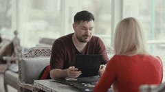 A man tells his companion about the menu. - stock footage