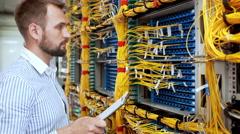 Engineer working in data room Stock Footage