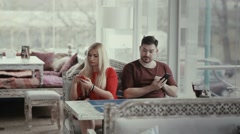A man looks at his companion's phone screen. - stock footage
