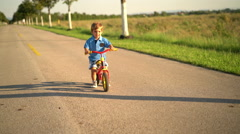 2 year old boy with walking bike Stock Footage