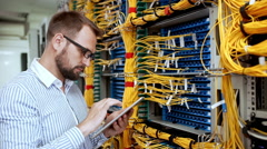 Engineer working in data room. Slow motion Stock Footage