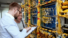 Engineers working in data room. Slow motion Stock Footage