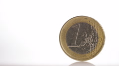4K One Euro coin balancing on white surface, with space for text Stock Footage
