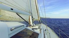 Sailingboat crusing the ocean Stock Footage