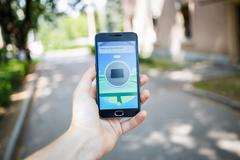 Moscow, Russia - August, 02: Android user play in Pokemon Go augmented reality Stock Photos