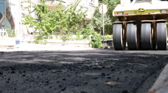 Road Under Construction, Pneumatic Tyred Roller Paver At Asphalt Road Stock Footage