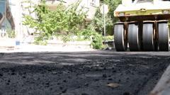 Road Under Construction, Pneumatic Tyred Roller Paver At Asphalt Road - stock footage