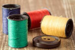 Spools of thread and button Stock Photos