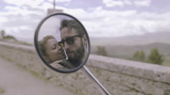 Reflection in side mirror of couple kissing Stock Footage