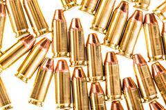 Pistol bullets isolated on white Stock Photos