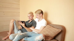 Happy gay couple using tablet in bed. gay couple Stock Footage