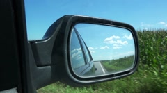 Wing mirror of car driving through corn field Stock Footage