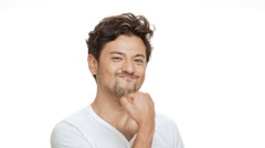 Young handsome man rejoicing over white background. Slow motion Stock Footage