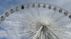 Ferris wheel with a cabin for vips. Observation wheel Stock Footage