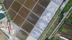 Aerial view of salt fields near town of Ston Stock Footage