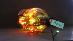 Beautiful text design of Merry Christmas, label and a vintage bottle with a - stock footage