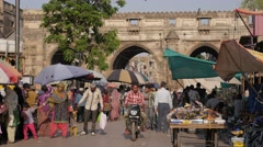 Street market with Teen Darwaja gate,Ahmedabad,India Stock Footage
