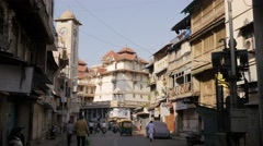 Busy street in old town with clock tower,Ahmedabad,India Stock Footage