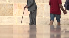 People and old man  go in a square in Valencia spain Stock Footage