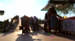 Blurred park visitors and people buying ice cream at stall. 4K shot Stock Footage