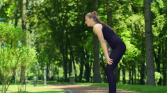 Tired female athlete after running hard outdoor. Fitness woman relaxing - stock footage