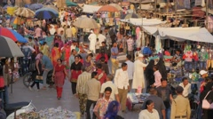 Busy market on Maidan Shahi with parasols,Ahmedabad,India Stock Footage