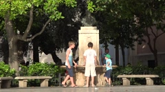 People  walking on Plaza de la Virgen  - square  in Valencia  spain Stock Footage