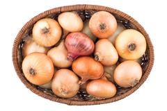 Basket with onion isolated on a white background. Stock Photos