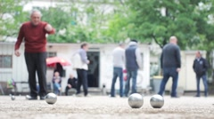 Group Of Seniors Playing Boules Stock Footage