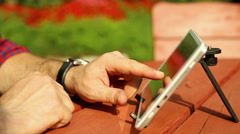 Man's hands are touching tablet Stock Footage