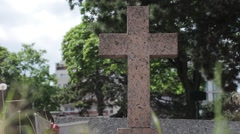 Holy Cross Tombstone In A Graveyard Stock Footage
