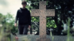 Man Prays In A Grave With Holy Cross, Cinematic Scene Stock Footage