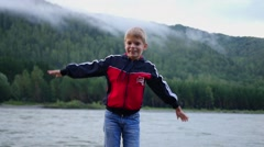 Child have fun waving his hands Stock Footage