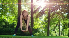 Fitness woman stretching outdoor at sunrise. Sporty woman fitness workout Stock Footage