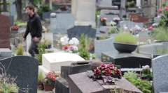 Man Prays In Grave In Cemetery Stock Footage