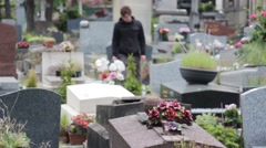 Young Man Arrives In Cemetery And Prays Stock Footage